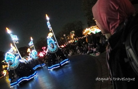 watching the night parade at Tokyo Disneyland